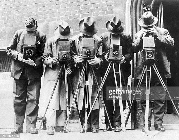 Pictured on the left is staff photographer George Greenwell resting the camera on his arm a man confident enough to work without a tripod George was...