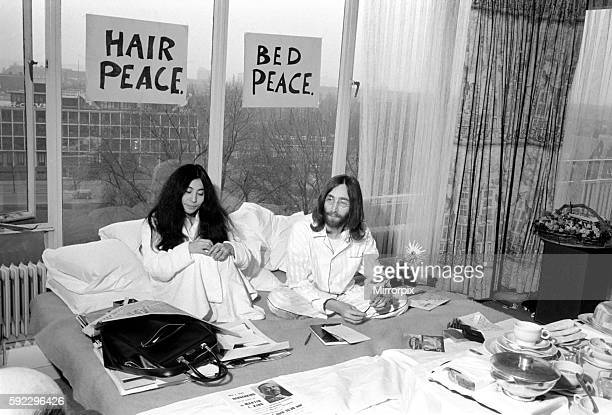 Pictured on their 'honeymoon' bed newly weds John Lennon and Yoko talking to Donald Zec about their seven day event at the Amsterdam Hilton Hotel...
