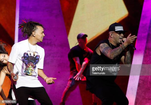 Ozuna and Wisin perform during rehearsals at the Watsco Center in the University of Miami Coral Gables Florida on April 26 2017
