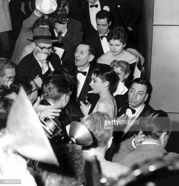Paparazzi surround best actress winner Audrey Hepburn in New York City