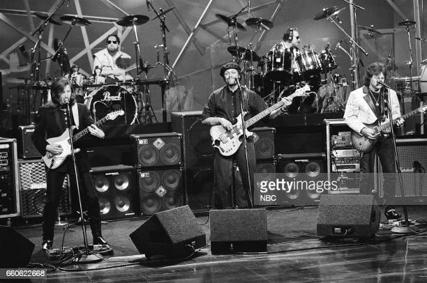 Patrick Simmons Tiran Porter and Tom Johnston of the musical guest The Doobie Brothers perform on June 17 1991