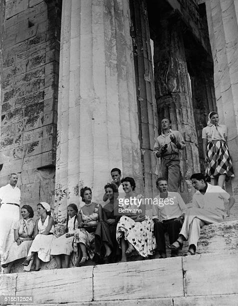 Pictured resting at the historic ruins of the Parthenon on the Acropolis are members of the Royal cruise aboard the SS Agamemnon Standing at the left...