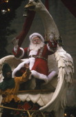 Santa Claus rides atop his float during the 1999 Macy's Thanksgiving Day Parade Photo by Craig Blankenhorn/NBCU Photo Bank