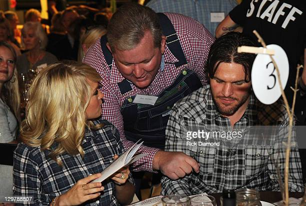 Pictured Singer/Songwriter Carrie Underwood NASCAR Pastor Joe Nelms' and NHL Nashville Predator Mike Fisher attend Singer/Songwriter Michael W Smith...