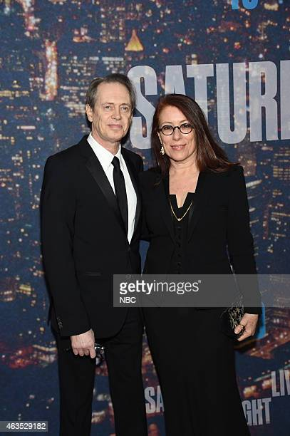 Steve Buscemi and guest walk the red carpet at the SNL 40th Anniversary Special at 30 Rockefeller Plaza in New York NY on February 15 2015