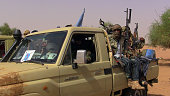 A pictured taken on July 13 2016 shows members of an armed group seating in a vehicle in Kidal Mali announced on July 21 it had opened an...
