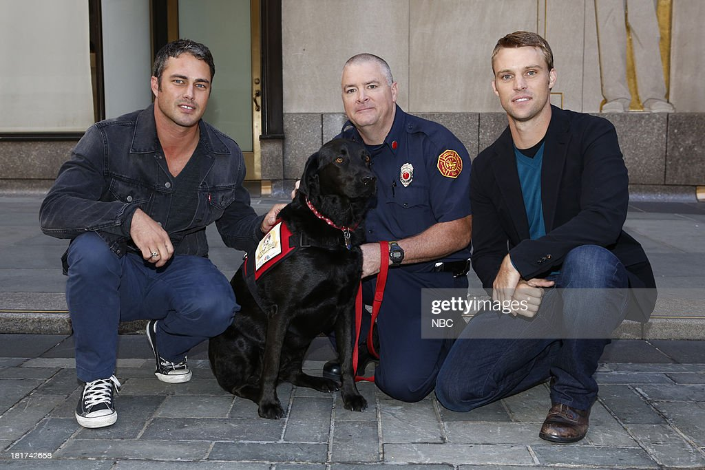 Taylor Kinney, Smokey, a firehouse dog from Jacksonville, Ill. in the running for the title of 'Top Dog' with trainer Todd Warrick, and Jesse Spencer appear on NBC News' 'Today' show --