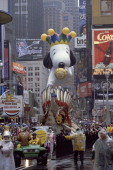 The American Indian float is followed by the Millenium Snoopy balloon in its first appearance during the 1999 Macy's Thanksgiving Day Parade Photo by...