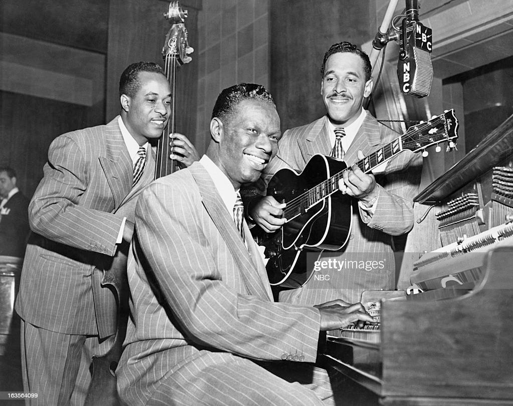 Bassist Johnny Miller, pianist/singer Nat King Cole, guitarist Oscar Moore --
