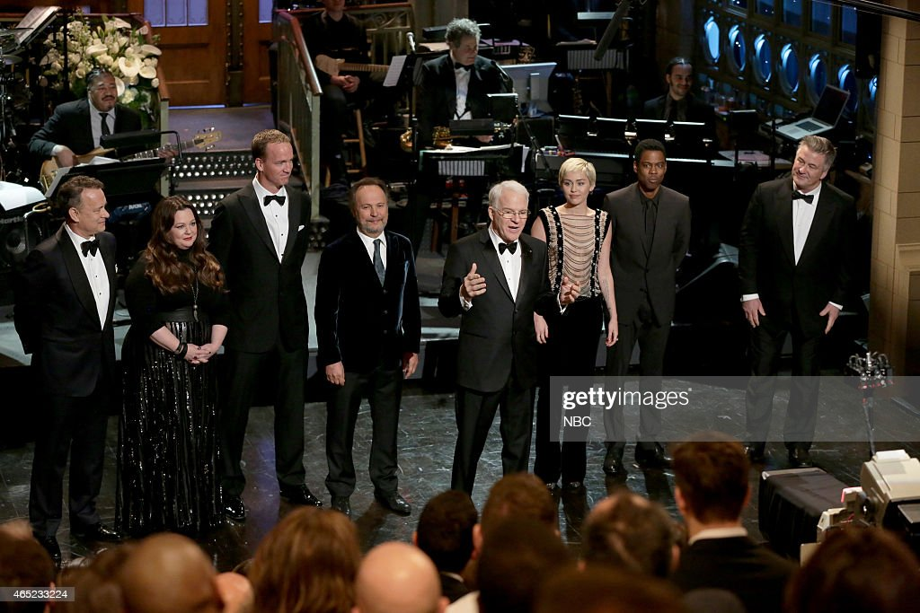 <a gi-track='captionPersonalityLinkClicked' href=/galleries/search?phrase=Tom+Hanks&family=editorial&specificpeople=201790 ng-click='$event.stopPropagation()'>Tom Hanks</a>, <a gi-track='captionPersonalityLinkClicked' href=/galleries/search?phrase=Melissa+McCarthy&family=editorial&specificpeople=880291 ng-click='$event.stopPropagation()'>Melissa McCarthy</a>, <a gi-track='captionPersonalityLinkClicked' href=/galleries/search?phrase=Peyton+Manning&family=editorial&specificpeople=184524 ng-click='$event.stopPropagation()'>Peyton Manning</a>, <a gi-track='captionPersonalityLinkClicked' href=/galleries/search?phrase=Billy+Crystal&family=editorial&specificpeople=202497 ng-click='$event.stopPropagation()'>Billy Crystal</a>, <a gi-track='captionPersonalityLinkClicked' href=/galleries/search?phrase=Steve+Martin+-+Comedian&family=editorial&specificpeople=196544 ng-click='$event.stopPropagation()'>Steve Martin</a>, <a gi-track='captionPersonalityLinkClicked' href=/galleries/search?phrase=Miley+Cyrus&family=editorial&specificpeople=3973523 ng-click='$event.stopPropagation()'>Miley Cyrus</a>, <a gi-track='captionPersonalityLinkClicked' href=/galleries/search?phrase=Chris+Rock&family=editorial&specificpeople=202982 ng-click='$event.stopPropagation()'>Chris Rock</a>, <a gi-track='captionPersonalityLinkClicked' href=/galleries/search?phrase=Alec+Baldwin&family=editorial&specificpeople=202864 ng-click='$event.stopPropagation()'>Alec Baldwin</a> during the 'Host Monologue' on February 15, 2015 --