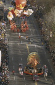 Turkey float followed by Mickey Mouse balloon during the 2000 Macy's Thanksgiving Day Parade