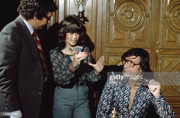 unknown Hefner's girlfriend/Singer Barbi Benton Playboy founder Hugh Hefner discussing promotional artwork for Barbi's 1974 debut album 'Barbi Doll'...
