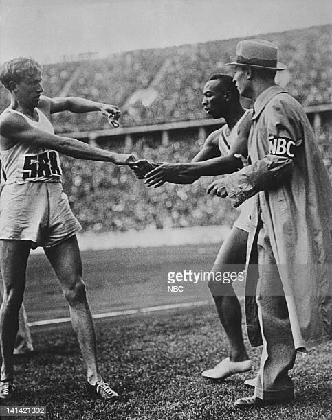 Unknown olympic athlete shaking hands with American olympian Jesse Owens Photo by NBCU Photo Bank