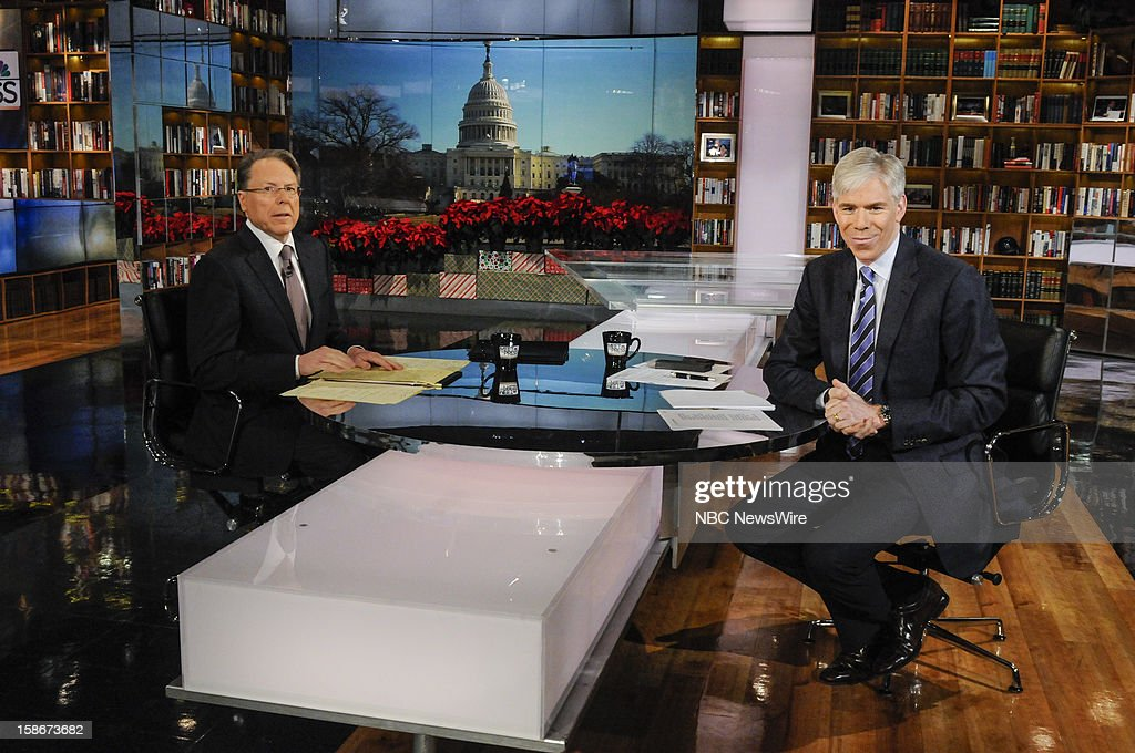 – Wayne LaPierre, CEO and Executive Vice President, National Rifle Association, left, and moderator David Gregory, right, appear on 'Meet the Press' in Washington D.C., Sunday, Dec. 23, 2012.
