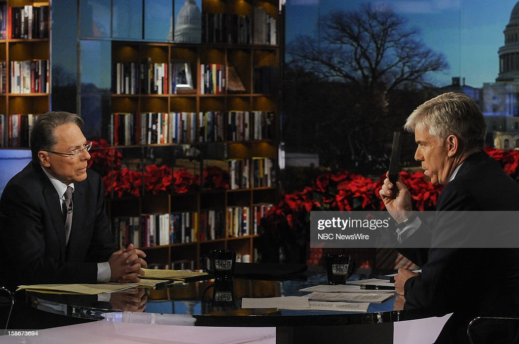 – Wayne LaPierre, CEO and Executive Vice President, National Rifle Association, left, and moderator David Gregory, holding a 30-round magazine, right, appear on 'Meet the Press' in Washington D.C., Sunday, Dec. 23, 2012.
