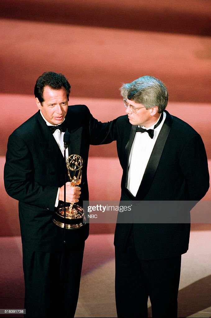 Winners for Outstanding Writing for a Comedy Series for 'The Larry Sanders Show' <a gi-track='captionPersonalityLinkClicked' href=/galleries/search?phrase=Garry+Shandling&family=editorial&specificpeople=220833 ng-click='$event.stopPropagation()'>Garry Shandling</a>, <a gi-track='captionPersonalityLinkClicked' href=/galleries/search?phrase=Peter+Tolan&family=editorial&specificpeople=2142159 ng-click='$event.stopPropagation()'>Peter Tolan</a> on stage during the 50th Annual Primetime Emmy Awards held at the Shrine Auditorium in Los Angeles, CA on September 13, 1998 --