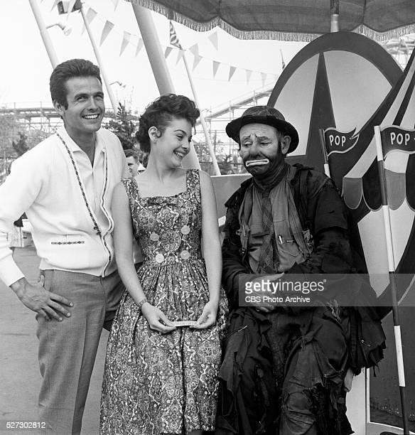 RINGO Pictured with Emmett Kelly the 'hobo clown' Mark Goddard of the CBS western 'Johnny Ringo' and Pennie Parker of the CBS comedy series 'Make...