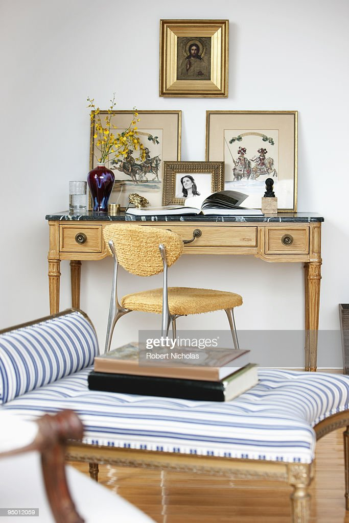 Pictures above desk in living room : Stock Photo