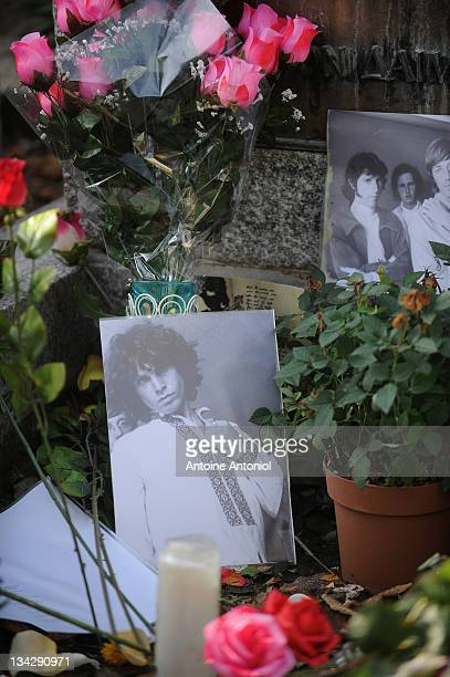 Pictures and flowers are seen on American singer Jim Morrison grave at Cimetierre du Pere Lachaise on November 29 2011 in Paris France