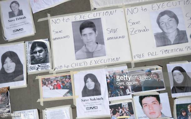 Pictures and posters showing cases of extreme punishment against people living under the Iranian regime are displayed on the floor during a...