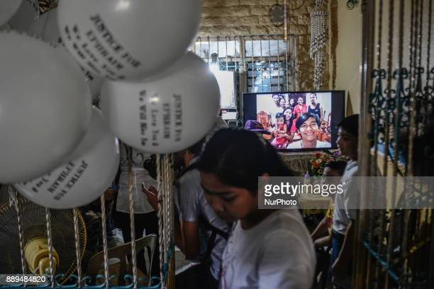 Pictures are played on a television during the funeral of Ephraim Escudero who was killed by unidentified assailants in San Pedro Laguna south of...