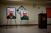 Pictures of escaped prisoners Richard Matt and David Sweat are displayed at a press conference in Saranac New York June 12 2015 Law enforcement...