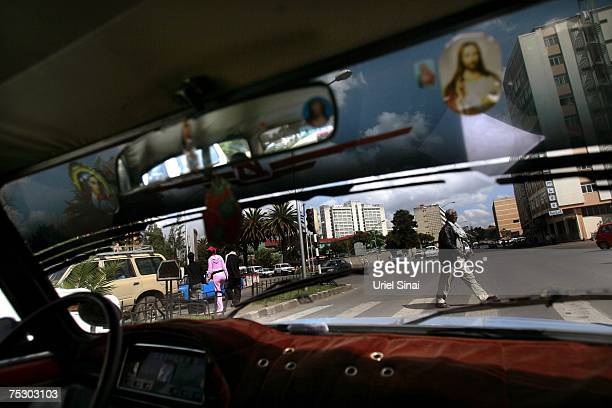 Pictures of Jesus are seen in a taxi as it makes its way through the streets of the Ethiopian capital Addis Ababa on April 27 2007 Jews are a...