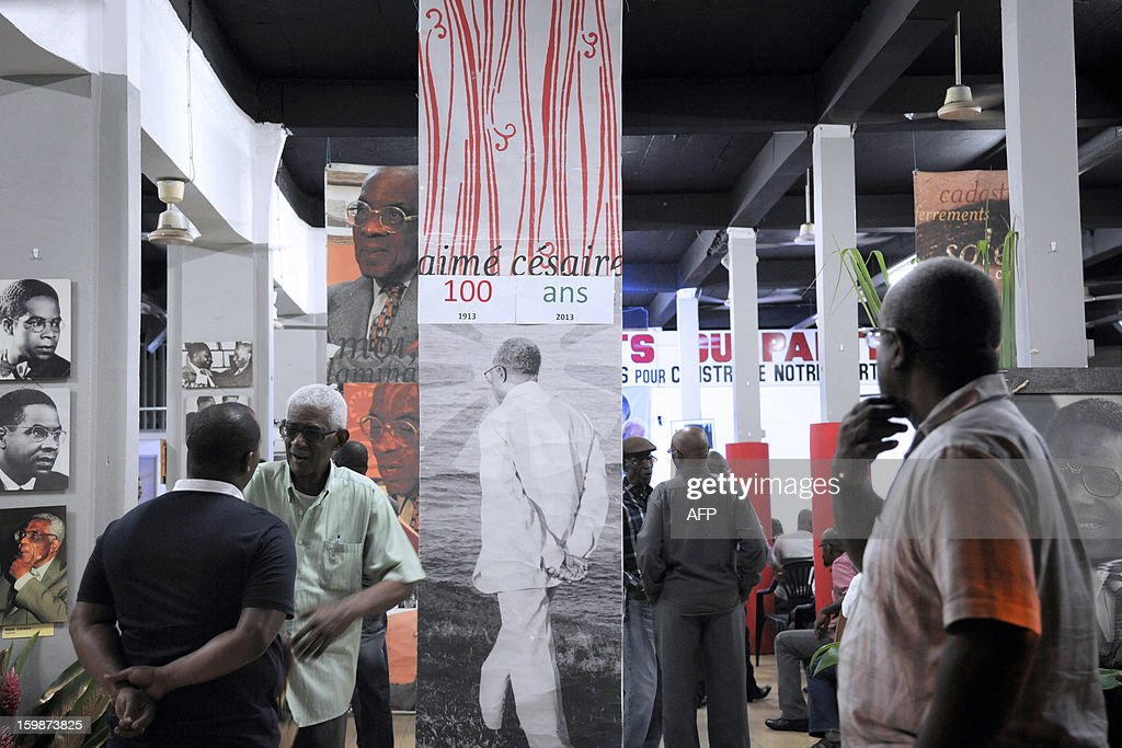 Pictures of late French poet and politician Aime Cesaire (C) are displayed on January 21, 2013 at the Martinican Progressive Party (PPM) headquarters in Fort-de-France, on the French Caribbean island of Martinique, marking the 100th anniversary of Cesaire's birth. Cesaire (June 25, 1913 – 17 April 2008) was former mayor of Fort-de-France and had funded the PPM party in 1958. As a pioneer of the black pride movement, Cesaire was a cult figure on his native island of Martinique and in the French-speaking world. With fellow writers such as Leopold Sedar Senghor of Senegal, 'Papa Cesaire' invented the term 'negritude,' which he defined as an 'affirmation that one is black and proud of it', decades before the emergence of Steve Biko or Martin Luther King.