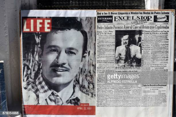 Pictures of Mexican singer and actor Pedro Infante are seen displayed at the Panteon Jardin during the 100th Anniversary of his birth in Mexico City...