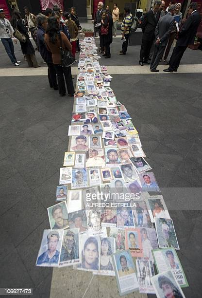 Pictures of missing immigrants from Honduras laid down by their mothers are seen during a demonstration outside of the Mexican Senate in Mexico City...
