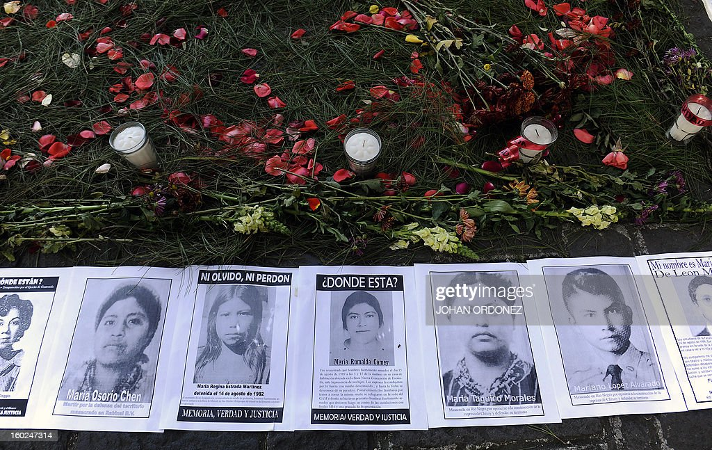 Pictures of people disappeared during the country's civil war are displayed outside the court during a hearing to former Guatemalan de facto President (1982-1983) and retired General Jose Efrain Rios Montt (not pictured) in Guatemala City on January 28, 2013. In a historic decision, a Guatemalan court announced today that Rios Montt, 86, will face trial for the genocide of indigenous peoples during his rule, becoming the first former president to be prosecuted for this crime in the country. The landmark decision marks the first time that genocide proceedings have been brought in the country over the 36-year civil war that ended in 1996, leaving an estimated 200,000 people dead, according to the UN. AFP PHOTO/Johan ORDONEZ