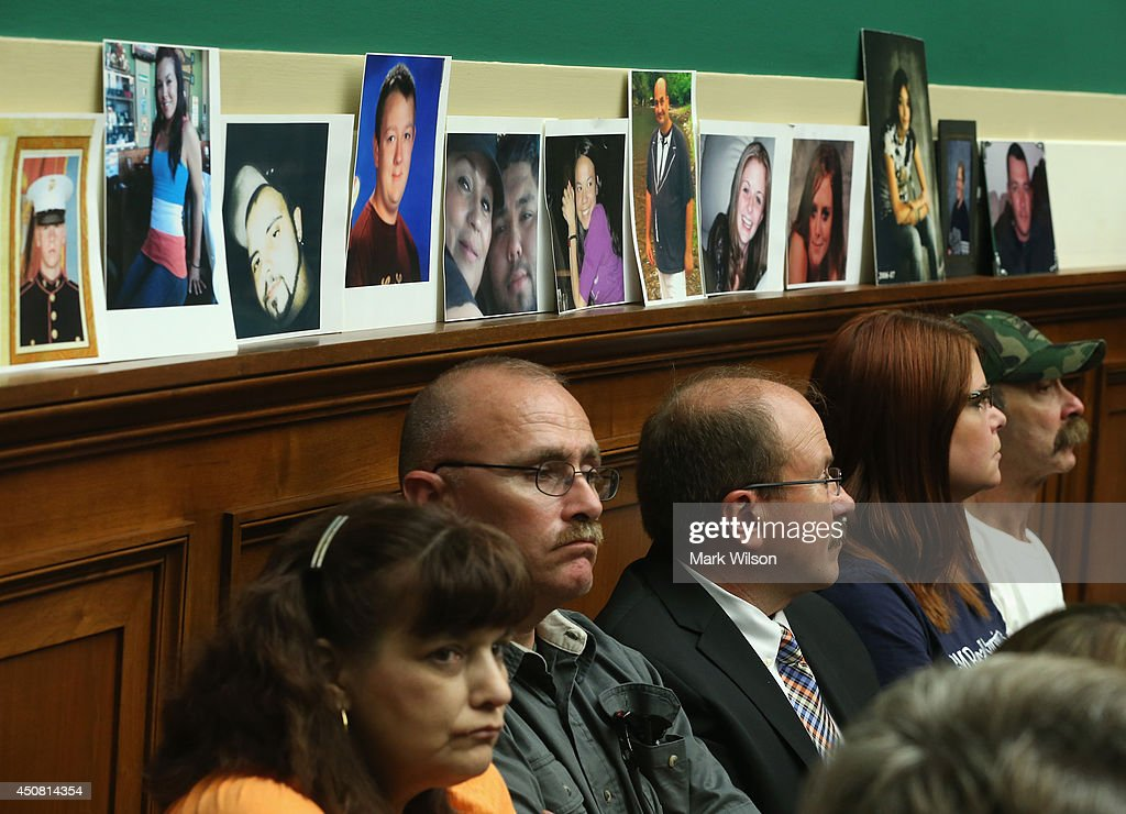 Pictures of people killed in GM cars with defected key switches were put on a ledge by family members while General Motors CEO Mary Barra testifies...
