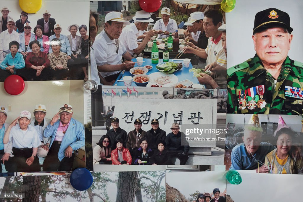 Pictures of POWs escaped from North Korea are seen on a wall of a care house on July 10, 2013 in Seoul, South Korea.