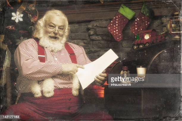 Pictures of Real Santa Claus checking his list twice