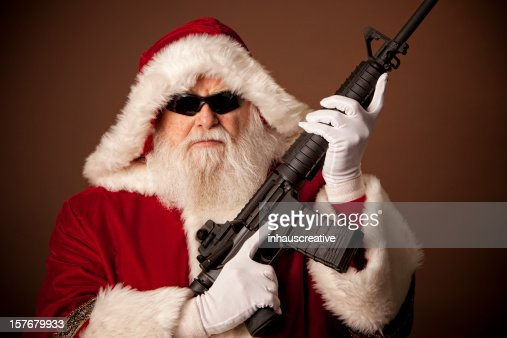 Pictures of real santa claus got a gun stock photo getty images