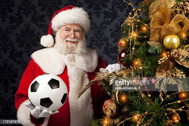 Foto reale di Babbo Natale con Pallone da calcio regalo