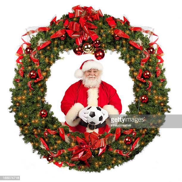 Foto reale di Babbo Natale in Corona di fiori con Pallone da calcio