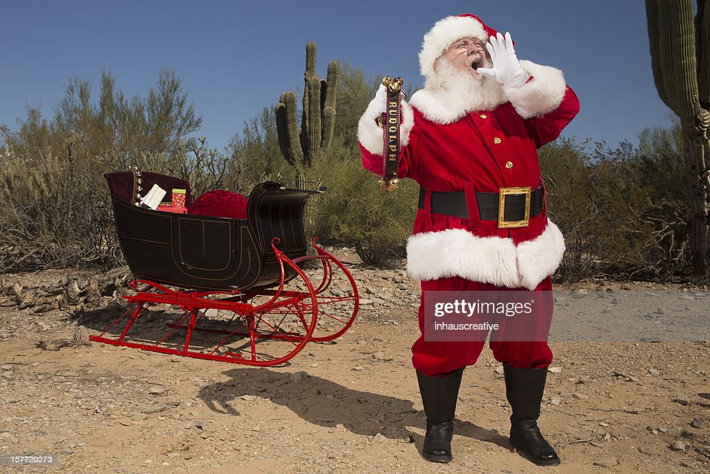 Santa Claus lost in desert yelling for Rudolph