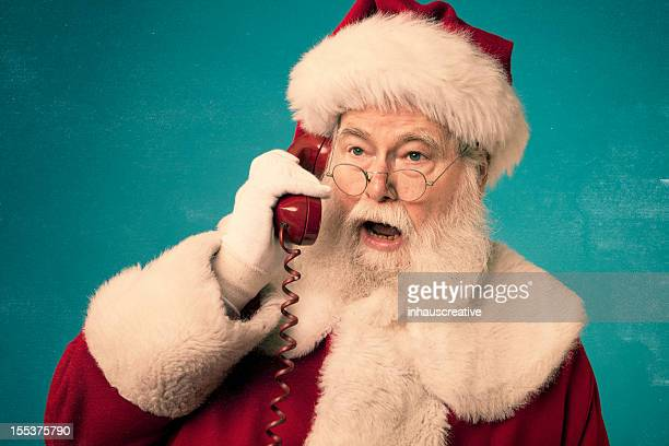Pictures of Real Santa Claus on red phone