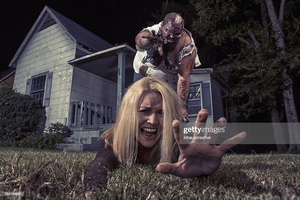 Zombie Victim grabbing for help : Stock Photo