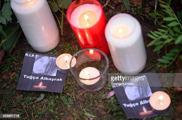 Pictures of Tugce with flowers and candles at the grave of Tugce Albayrak the 23yearold university student who died after she was attacked in a...