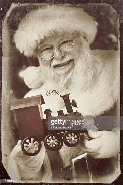 pictures of Vintage Real Santa Claus holding a toy train
