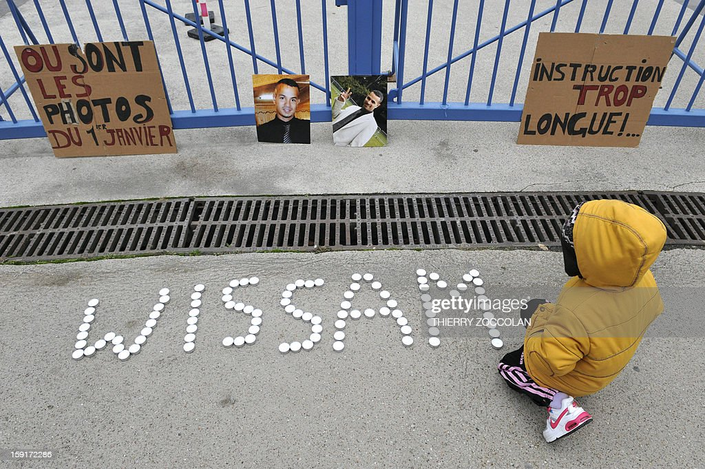 Pictures of Wissam El-Yamni, a young man who died following his arrest one year ago have been set at the entrance of Clermont-Ferrand's courthouse, on January 1, 2013, during a demonstration to call for 'the truth' regarding his the death. AFP PHOTO THIERRY ZOCCOLAN