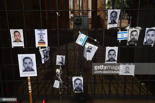 Pictures of Yosi Damari a 22 yearold man from Israel who was found beaten to death and Israeli flags hang at a gate at the ruins of the downtown...