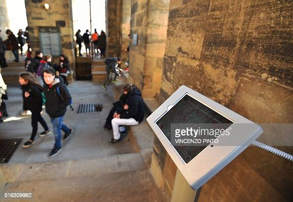 A pictures shows a digital graffiti on a tablet screen on March 17 2016 during a visit at the Giotto's bell tower of Santa Maria del Fiore cathedral...
