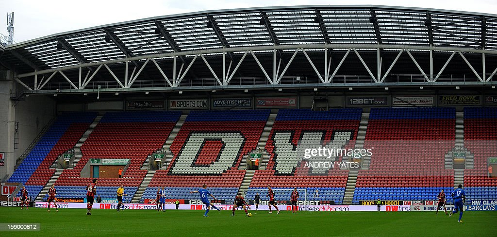 "A pictures shows a stand empty of spectators during the English FA Cup third round football match between Wigan Athletic and Bournemouth at The DW Stadium in Wigan, north-west England on January 5, 2013. USE. No use with unauthorized audio, video, data, fixture lists, club/league logos or ""live"" services. Online in-match use limited to 45 images, no video emulation. No use in betting, games or single club/league/player publications."