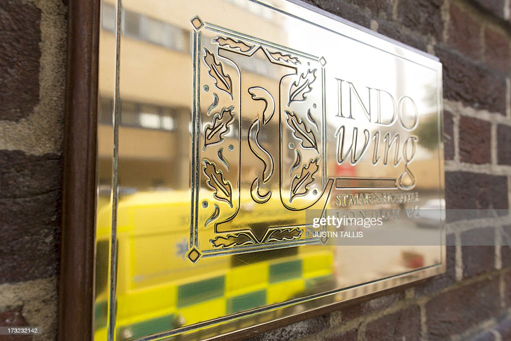 A pictures shows an ambulance reflected in a sign waiting outside The Lindo Wing of Saint Mary's Hospital in London on July 10, 2013. Prince William and his wife Catherine's baby, which will be third in line to the throne, will be born in the private Lindo wing of St Mary's Hospital, where William was born in 1982 and his brother Harry in 1984. AFP PHOTO / JUSTIN TALLIS
