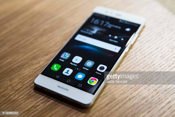 A pictures shows the new P9 smartphone by Chinese tech company Huawei during the phone's launch at Battersea Evolution in London on April 6 2016 The...