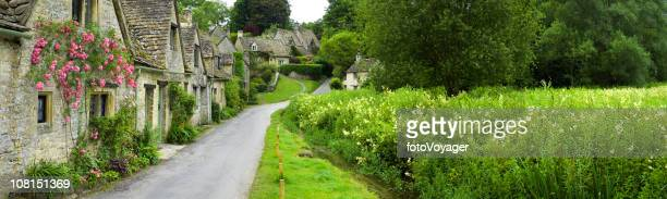 Picturesque English cottages water meadow Cotswold village panorama Arlington Row