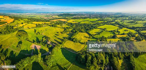 Picturesque rural landscape patchwork fields farms country village aerial panorama